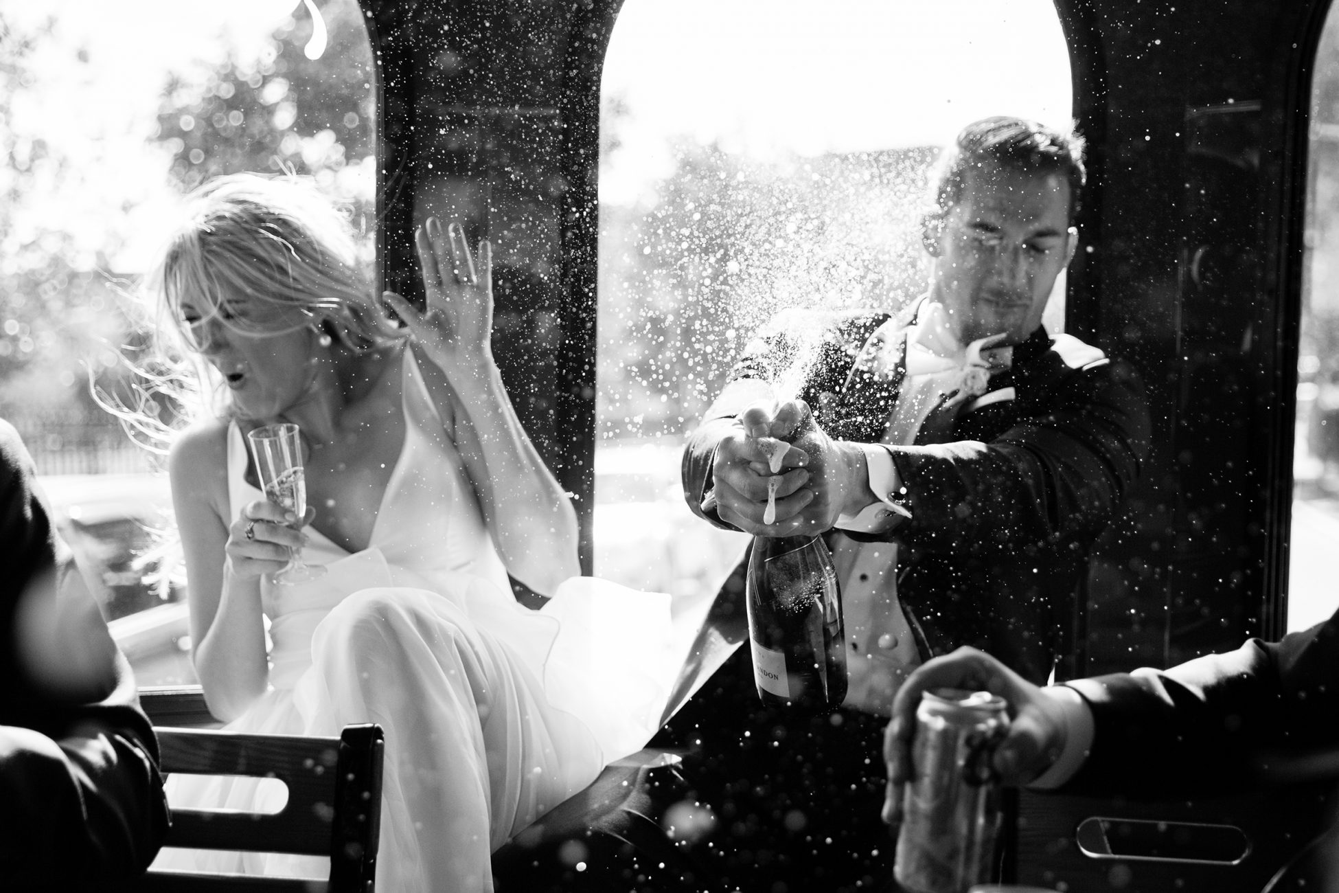 champagne sprays on bride and groom at portland maine wedding