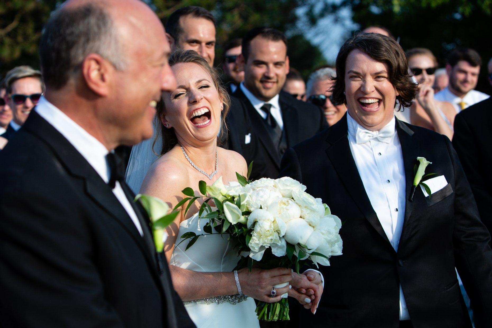 brides laugh at their same sex wedding ceremony at belle mer