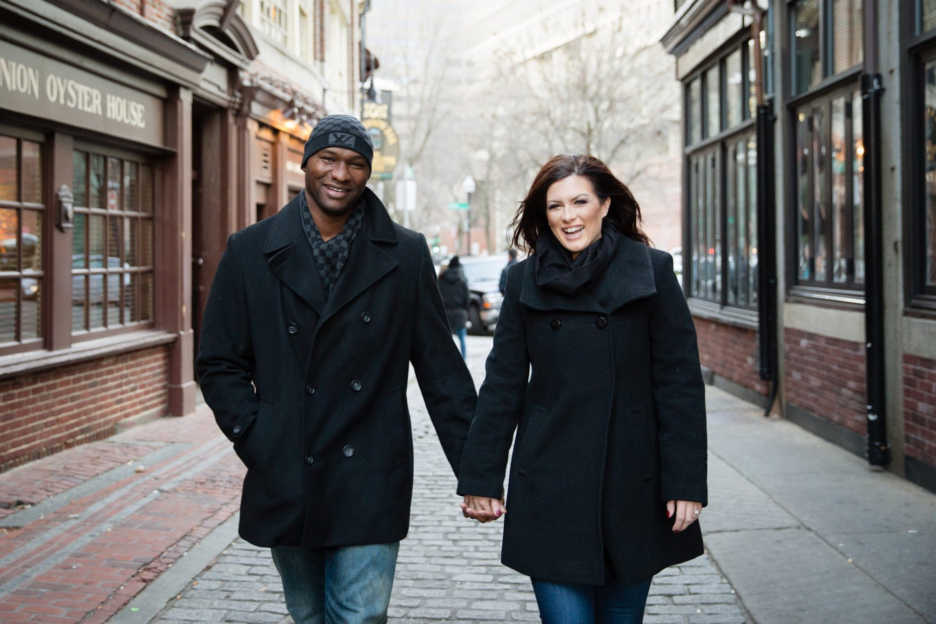 north end boston couple poses for engagement photos