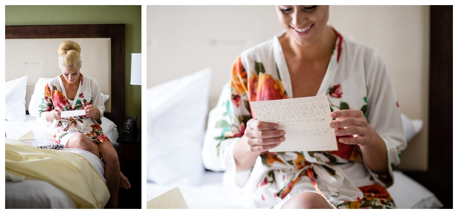 bride reads a card from the groom on her wedding day