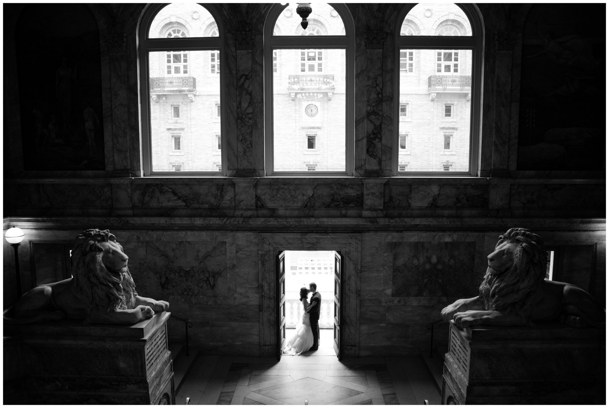 photo at the top of the staircase at the boston public library