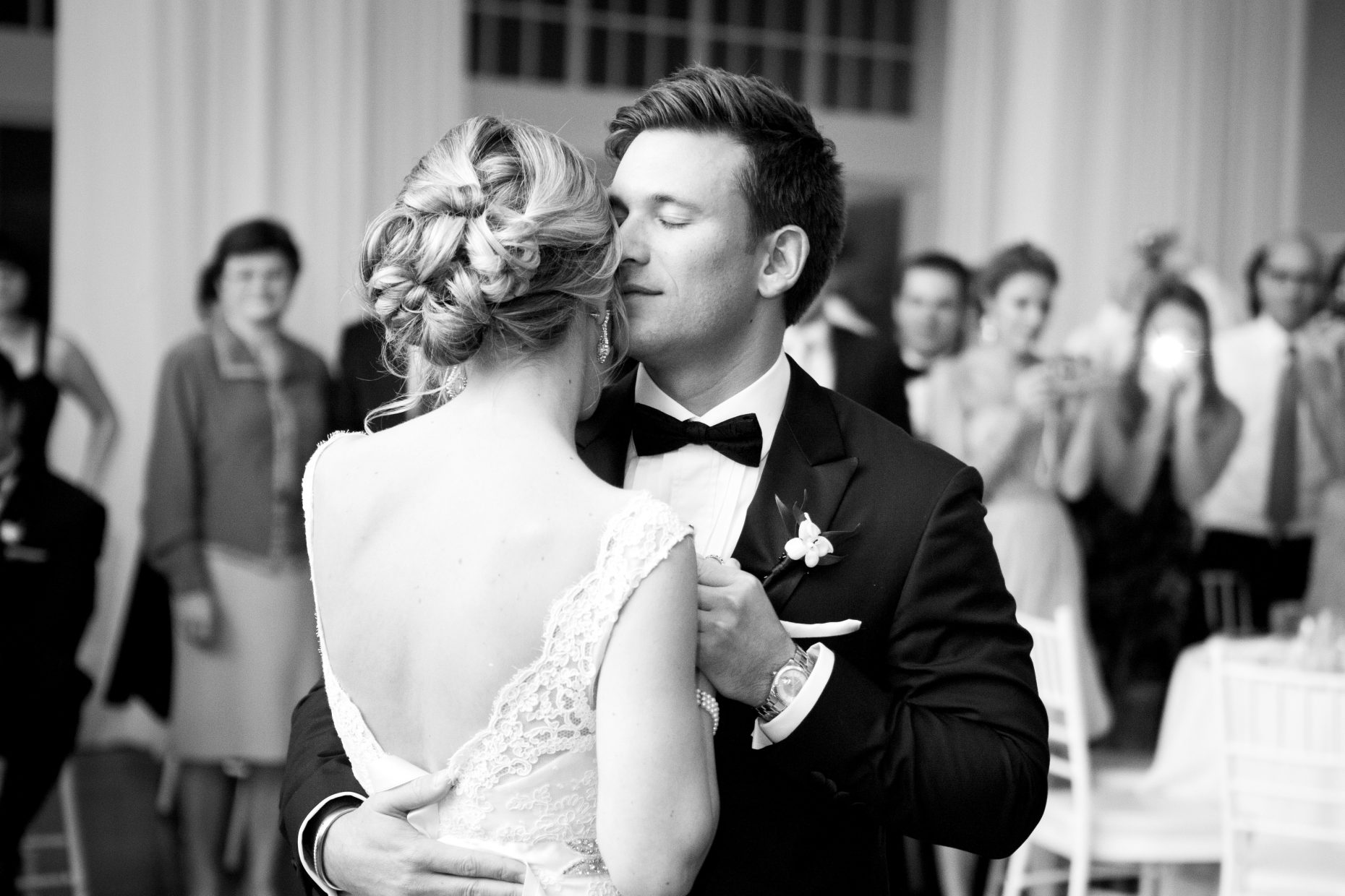 groom closes his eyes during first dance at belle mer water salon