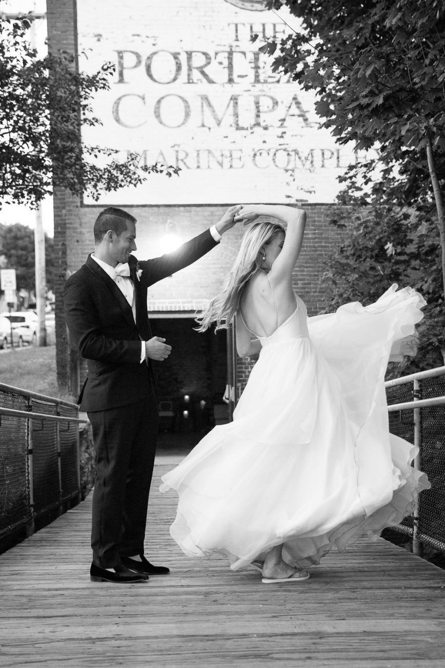 groom spins bride in front of portland company complex maine
