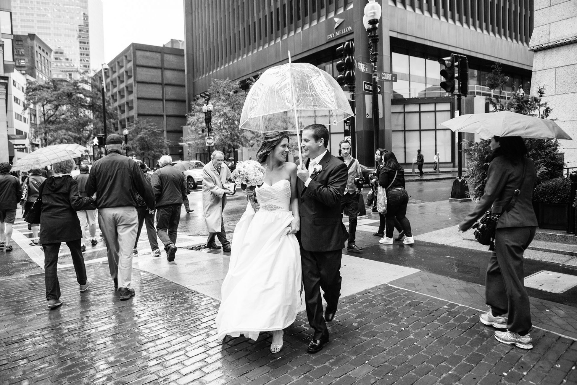 a newly married couples walks to their state room wedding with an umbrella