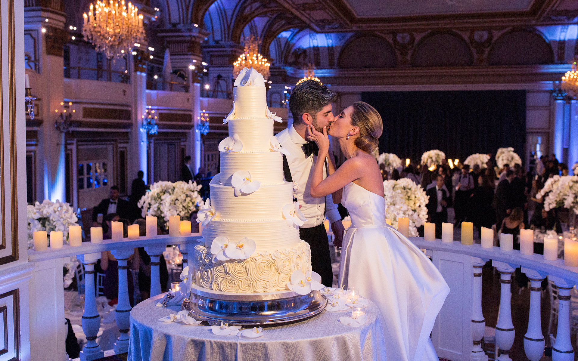 couple cuts their wedding cake at the fairmont copley plaza hotel in boston